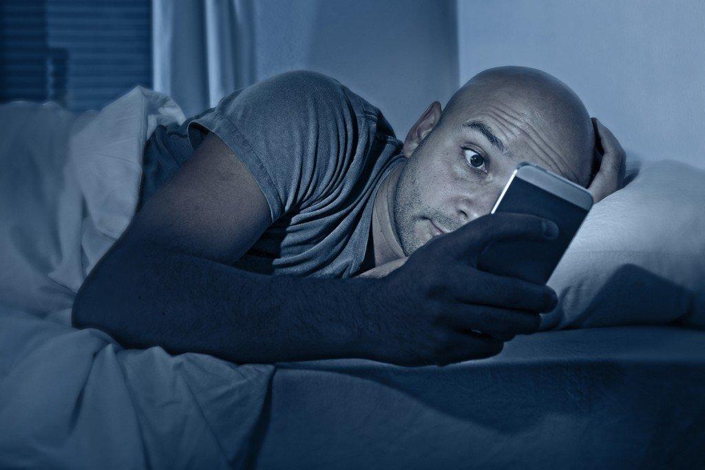 man on his phone at night