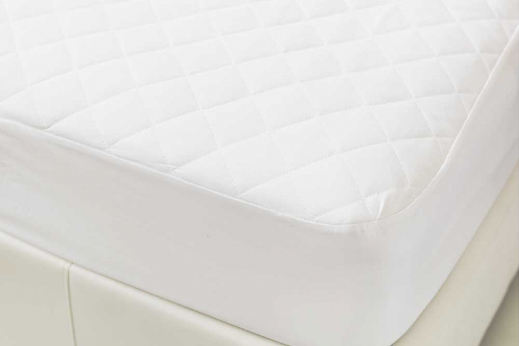 mattress protector on bed